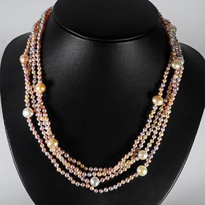 243.60 Ct. Lively Natural Orange Pearl Strands 78 Inch