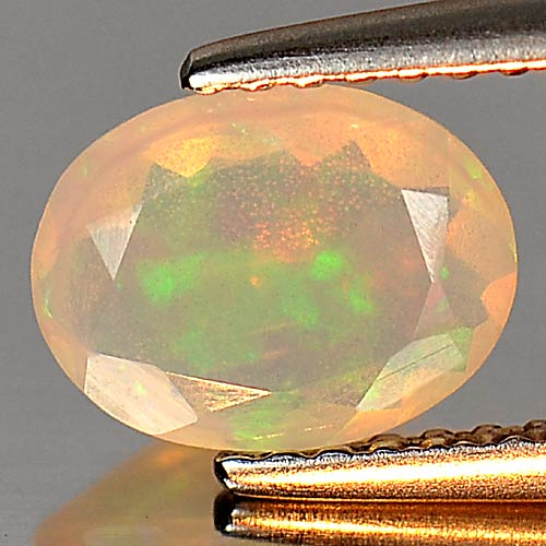 0.58 Ct. Attractive Natural Gem Multi Color Play Of Colour Opal Oval Shape