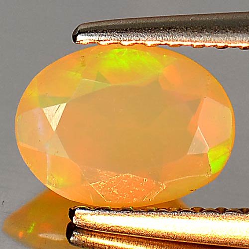 0.57 Ct. Sz 8 x 6 Mm. Oval Natural Multi Color Play Of Colour Opal Gem