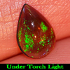 0.65 Ct. Pear Cab Natural Gemstone Play Of Color Rainbow Fire Red Black Opal
