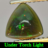 0.63 Ct. Trilliant Cabochon Natural Play Of Color Rainbow Fire Red Black Opal