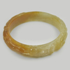 255.25 Ct. Natural Gem Honey Brown Jade Bangle Dragon Carving Size 80x65x15 mm.
